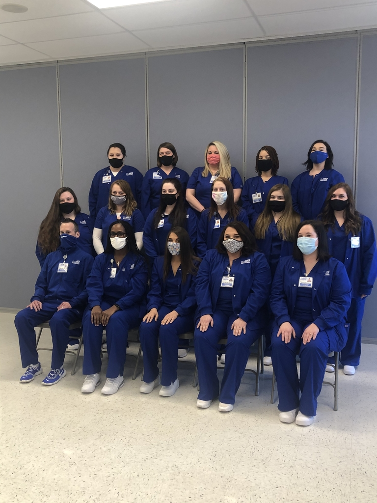 Nursing students in blue scrubs